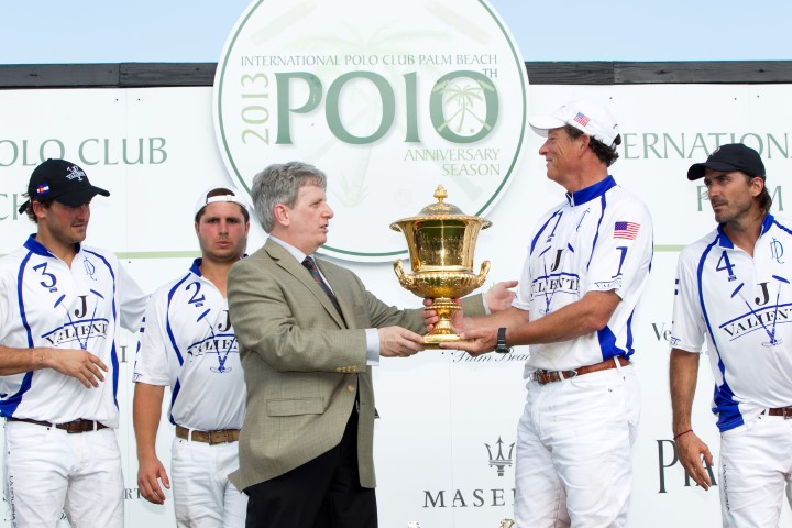 Larry Boland presenting the Piaget Gold Cup to Valiente