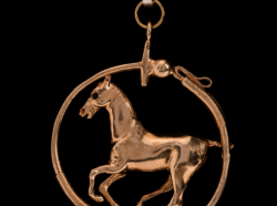 14 kt Gold Circular Polo Pony Pendant with a Sapphire Eye wrapped in a Polo Mallet with a Polo Ball